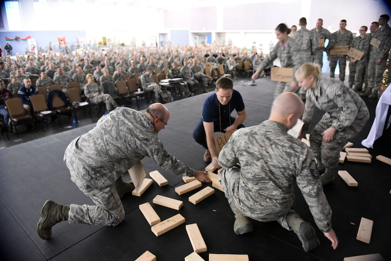 Chief Master Sgt. Pat Halko lends a hand to Guardsmen during a skit performed during the 120th Airlift Wing's Wingman Day event December 3, 2016 at the Mansfield Center in Great Falls, Montana. The skit demonstrated the appropriate utilization of Guardsmen.  (U.S. Air National Guard photo/Master Sgt. Michael Touchette)