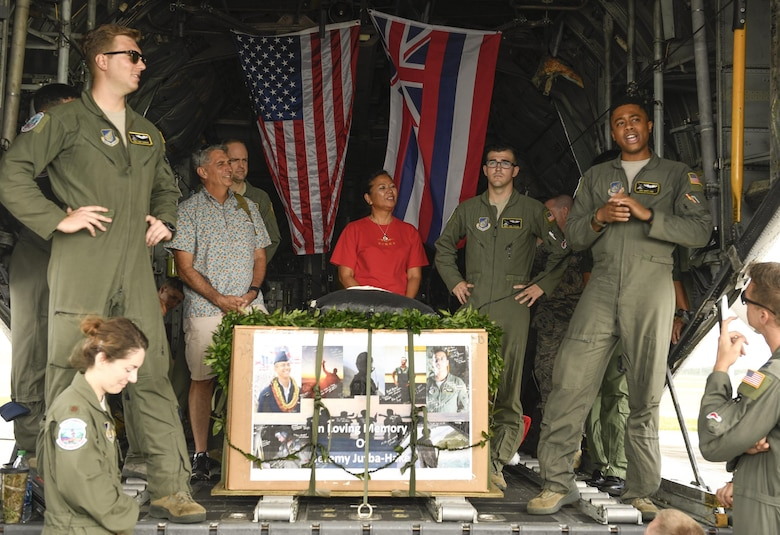 Fellow Airmen, friends and family of the late Senior Airman Jeremy Jutba-Hake, 36th Airlift Squadron instructor loadmaster, speak at his remembrance ceremony at Andersen Air Force Base, Guam, Dec. 6, 2016. Jutba-Hake collapsed during post-flight duties following a training mission during Operation Christmas Drop 2015. On day two of OCD 2016, participants gathered for a remembrance ceremony before beginning the day's mission. (U.S. Air Force photo by Senior Airman Elizabeth Baker/Released)