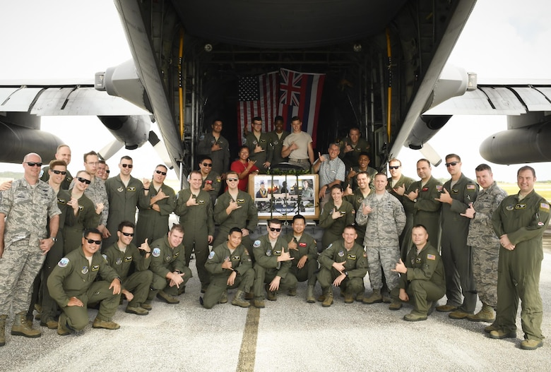 Colleagues, friends and family of the late Senior Airman Jeremy Jutba-Hake, 36th Airlift Squadron instructor loadmaster, gather for his remembrance ceremony at Andersen Air Force Base, Guam, Dec. 6, 2016. Jutba-Hake collapsed during post-flight duties following a training mission during Operation Christmas Drop 2015. On day two of OCD 2016, participants took time to remember him before beginning the day's mission. (U.S. Air Force photo by Senior Airman Elizabeth Baker/Released)