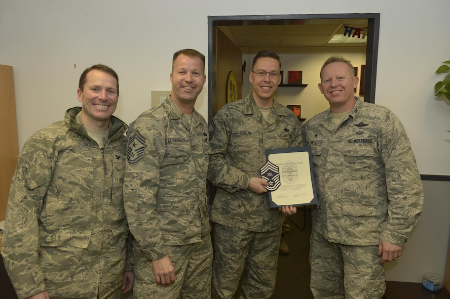 Senior Master Sgt. Ryan Strub, center right, 52nd Logistic Readiness Squadron fuels management flight superintendent, receives notification he has been selected for promotion to chief master sergeant from Col. Joe McFall, right, 52nd Fighter Wing commander, Col. Steven Horton, left, 52FW vice commander, and Chief Master Sgt. Edwin Ludwigsen, center left, 52FW command chief, at Spangdahlem Air Base, Germany, Dec. 7, 2016. The