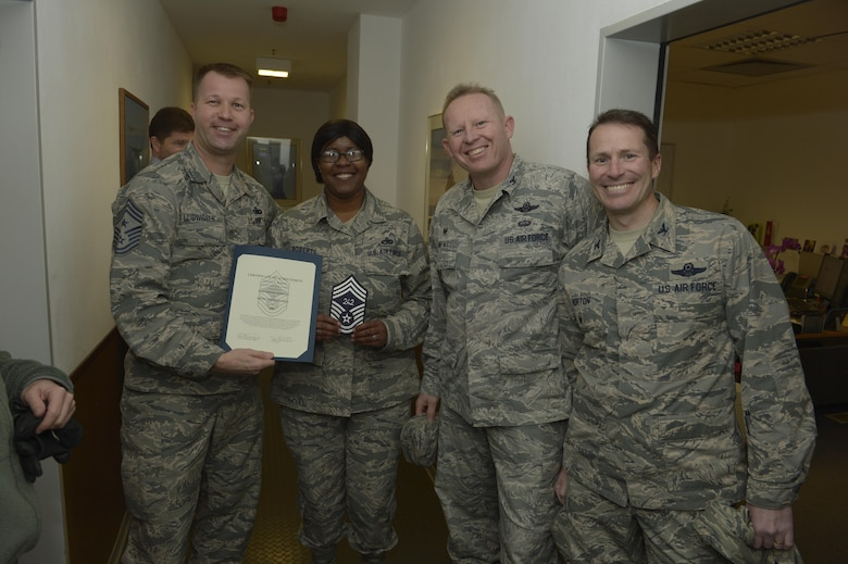 Senior Master Sgt. Latrica Roberts, center left, 52nd Logistic Readiness Squadron traffic management flight superintendent, receives notification she has been selected for promotion to chief master sergeant from Col. Joe McFall, center right, 52nd Fighter Wing commander, Col. Steven Horton, right, 52FW vice commander, and Chief Master Sgt. Edwin Ludwigsen, left, 52FW command chief, at Spangdahlem Air Base, Germany, Dec. 7, 2016. The selected senior master sergeant will later be inducted into the top one percent of the Air Force's enlisted ranks. (U.S. Air Force photo by Staff Sgt. Jonathan Snyder)