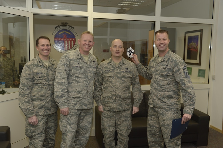 Senior Master Sgt. John Agnew, center right, 52nd Civil Engineer Squadron facility systems superintendent, receives notification he has been selected for promotion to chief master sergeant from Col. Joe McFall, center left, 52nd Fighter Wing commander, Col. Steven Horton, left, 52FW vice commander, and Chief Master Sgt. Edwin Ludwigsen, right, 52FW command chief, at Spangdahlem Air Base, Germany, Dec. 7, 2016. The selected senior master sergeant will later be inducted into the top one percent of the Air Force's enlisted ranks. (U.S. Air Force photo by Staff Sgt. Jonathan Snyder)