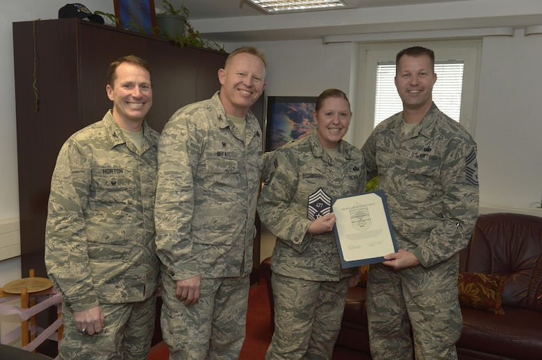 Senior Master Sgt. Jennifer Richbourg, center right, 52nd Force Support Squadron sustainment services superintendent, receives notification she has been selected for promotion to chief master sergeant from Col. Joe