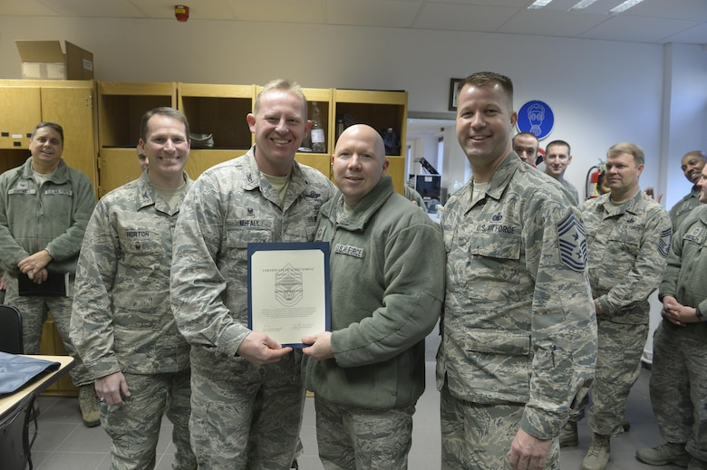 Senior Master Sgt. Brandon Dunston, center right, 52nd Maintenance Group quality assurance superintendent, receives notification he has been selected for promotion to chief master sergeant from Col. Joe McFall, center left, 52nd Fighter Wing commander, Col. Steven Horton, left, 52FW vice commander, and Chief Master Sgt. Edwin Ludwigsen, right, 52FW command chief, at Spangdahlem Air Base, Germany, Dec. 7, 2016. The selected senior master sergeant will later be inducted into the top one percent of the Air Force's enlisted ranks. (U.S. Air Force photo by Staff Sgt. Jonathan Snyder)