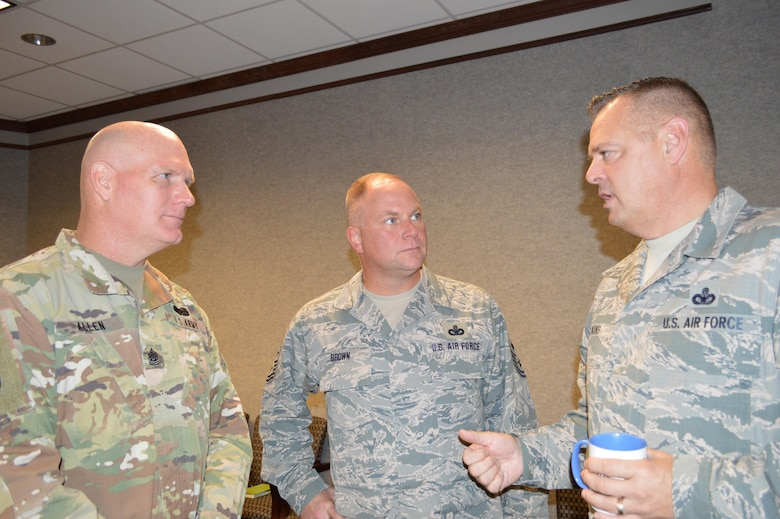 (From left) West Virginia Army National Guard Command Sergeant Maj. James Allen and Air National Guard Enlisted Force Advisory Council Chairman and Kansas National Guard Senior Enlisted Leader, Chief Master Sgt. James Brown, listen to a point by Chief Master Sgt. Richard King, Continental U.S. Aerospace Defense Region-1st Air Force (AFNORTH) Command Chief, during the Enlisted Force Advisory Council Meeting at Tyndall Air Force Base, Fla., Dec. 6-7. It was the first time a command sergeant major attended the Air National Guard EFAC event as it was determined similar issues for enlisted forces existed across both armed service brances. Brown will attend the next Army Command Sergeant Major Advisory Council meeting. (Photo by Mary McHale)