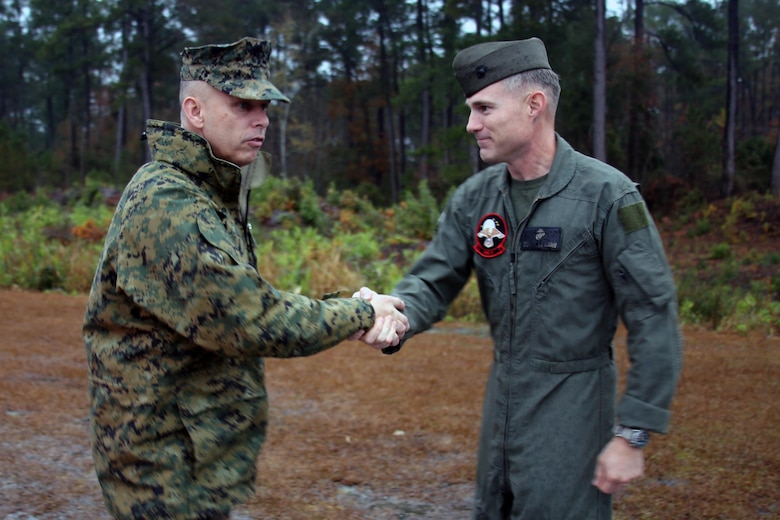 """Brig. Gen. Matthew Glavy shakes hands with Lt. Col. Lawrence B. Green II aboard Marine Corps Air Station Cherry Point, N.C., Dec. 6, 2016. Glavy addressed some challenges that Marine Unmanned Aerial Vehicle Squadron 2, Marine Aircraft Group 14, 2nd Marine Aircraft Wing is currently facing as they continue to maintain readiness and stay in the fight. """"In this time of challenge, it is your task to be that guy or gal in the arena,"""" said Glavy to the Marines of VMU-2. """"I want you to walk with your heads up high, and keep focus on what we're doing."""" Glavy is the commanding general of 2nd MAW, and Green is the commanding officer of VMU-2. (U.S. Marine Corps photo by Lance Cpl. Mackenzie Gibson/Released)"""