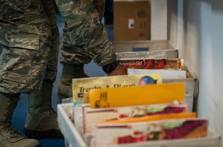An Airman volunteering at the Northside Post Office sifts through a box of mail before putting it in their corresponding mail boxes at Ramstein Air Base, Germany, Dec. 8, 2016. Volunteers can help make a difference in the community and aid in maintaining morale through dozens of volunteer opportunities during the holiday season. (U.S. Air Force photo by Airman 1st Class Lane T. Plummer)