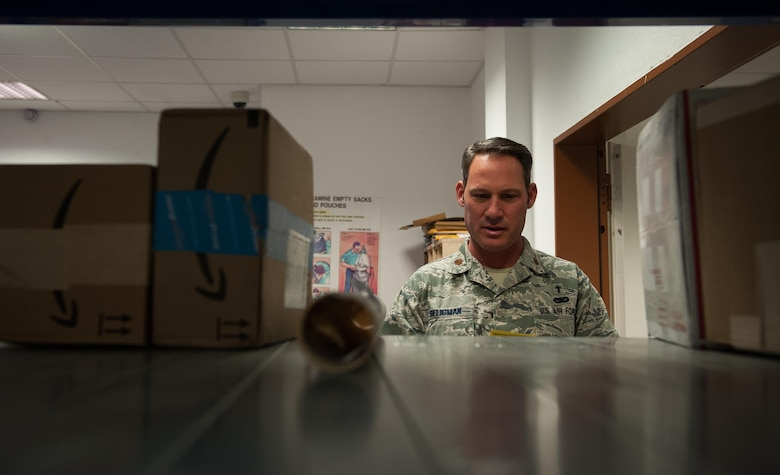 Maj. Chuck Seligman, 86th Airlift Wing chapel branch chief, helps postal specialists at the Northside Post Office at Ramstein Air Base, Germany, Dec. 8, 2016. Volunteer opportunities arise across the Kaiserslautern Military Community constantly, and some venues to reach out to the local communities in need are the United Service Organizations, located at the Ramstein Passenger Terminal, or the chapel.  (U.S. Air Force photo by Airman 1st Class Lane T. Plummer)