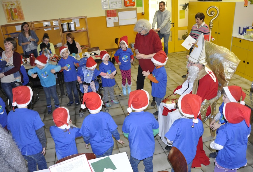 A group of Kindergarten children, belonging to the Bitburg Saint Martin school performed a dance during the school's annual Saint Nicholas celebration, Dec. 5 in Bitburg. The event included a visit by Saint Nicholas, dances and singing performances by the children, as well as a gift presentation by the 52nd Fighter Wing. The celebration was attended by Saint Martin school officials, parents, 52nd Fighter Wing leadership spouses, as well as Airmen and civilians from the wing, who provided gifts to students and kindergarten children.  In the summer, Spangdahlem Sabers invited the Saint Martin school to Special Children's Day at Spangdahlem AB, where they played games and spent a fun-filled time together. (U.S. Air Force photo by Iris Reiff)