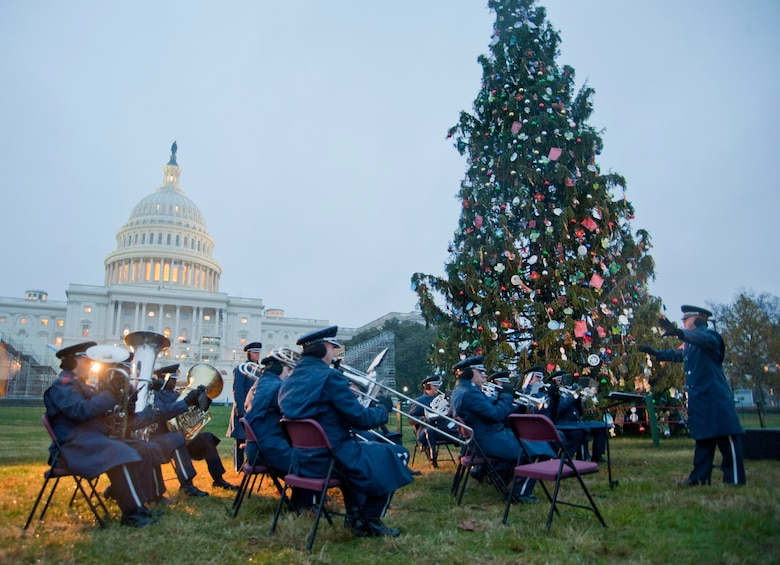 Capt. Dustin Doyle (right), U.S. Air Force Ceremonial Brass Band flight commander, conducts the band during the U.S. Capitol Christmas Tree Lighting Ceremony on the Capitol's West Front Lawn in Washington D.C., Dec. 6, 2016. By performing Christmas classic standards during the ceremony, the band accomplishes its mission to inspire American citizens to heightened patriotism.