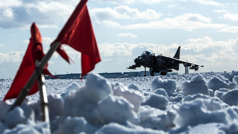 A U.S. Marine Corps AV-8B Harrier with Marine Attack Squadron (VMA) 542 taxis down the runway at Chitose Air Base, Japan, Dec. 8, 2016. Four of VMA-542's Harriers are conducting flight training daily out of Chitose as part of the Aviation Training Relocation Program. The ATR is an effort to increase operational readiness between the U.S. Marine Corps and the Japan Air Self Defense Force, improve interoperability and reduce noise concerns of aviation training on local communities by disseminating training locations throughout Japan. (U.S. Marine Corps photo by Cpl. James A. Guillory)