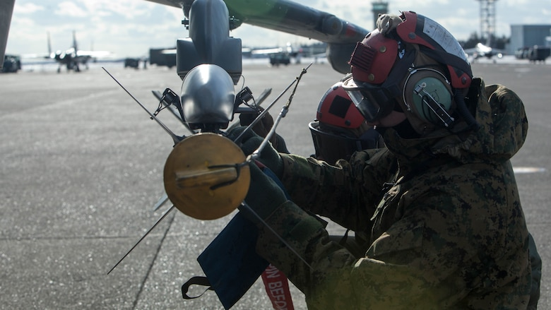 U.S. Marines with Marine Attack Squadron (VMA) 542 conduct preflight inspections during the Aviation Training Relocation Program at Chitose Air Base, Japan, Dec. 8, 2016. During the ATR the Marines with the power line division for VMA-542 have ensured the safety of all aircraft involved through routine flight inspections, launching the aircraft and recovering the aircraft. (U.S. Marine Corps photo by Cpl. James A. Guillory)
