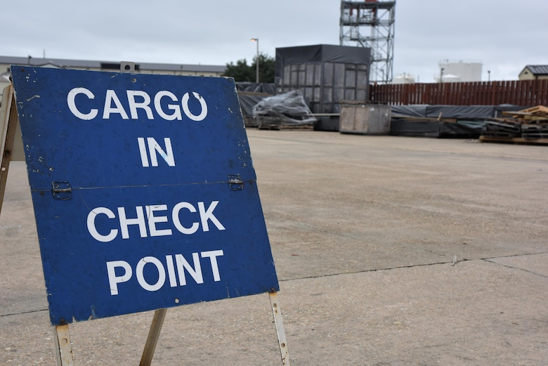 A cargo In check point sign sits at the supply warehouse loading docks during a deployment exercise Dec. 7, 2016, on Keesler Air Force Base, Miss. The exercise scenario tested the mission readiness of Team Keesler for simultaneous world-wide deployments. (U.S. Air Force photo by Kemberly Groue)