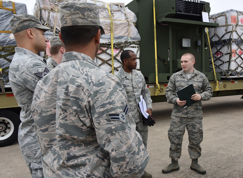Medical logistics technicians from the 81st Medical Support Squadron participate in a deployment exercise at the supply warehouse loading docks Dec. 7, 2016, on Keesler Air Force Base, Miss. The exercise scenario tested the mission readiness of Team Keesler for simultaneous world-wide deployments. (U.S. Air Force photo by Kemberly Groue)