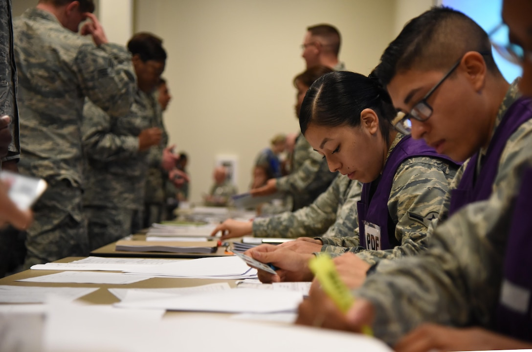 Airman Brenda Prudencio, 81st Force Support Squadron customer support technician, verifies deployment eligibility at the Roberts Consolidated Aircraft Maintenance Facility during a deployment exercise Dec. 8, 2016, on Keesler Air Force Base, Miss. The exercise scenario tested the mission readiness of Team Keesler for simultaneous world-wide deployments. (U.S. Air Force photo by Kemberly Groue)