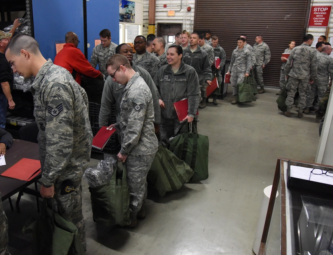 Keesler personnel receive mobility bag items at the supply warehouse during a deployment exercise Dec. 8, 2016, on Keesler Air Force Base, Miss. The exercise scenario tested the mission readiness of Team Keesler for simultaneous world-wide deployments. (U.S. Air Force photo by Kemberly Groue)