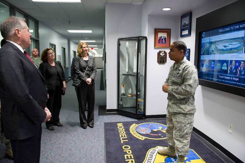 Second Lt. Jose Rosario briefs Under Secretary of Defense for Acquisition, Technology and Logistics Frank Kendall and Under Secretary of the Air Force Lisa S. Disbrow Dec. 7, 2016, at the Morrell Operations Center located on Cape Canaveral Air Force Station, Fla. The MOC is where all range operations take place to monitor the Eastern Range during launches.