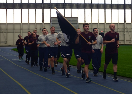 Members from the 28th Contracting and Comptroller Squadrons participate in the second annual Prisoner of War/Missing in Action 24-hour run at Ellsworth Air Force Base, S.D., Dec. 6 to 7, 2016. Participants ran in 30 minute shifts while carrying the POW/MIA flag as a way to honor and remember those who did not make it home. (U.S. Air Force photo by Airman 1st Class Denise M. Jenson)