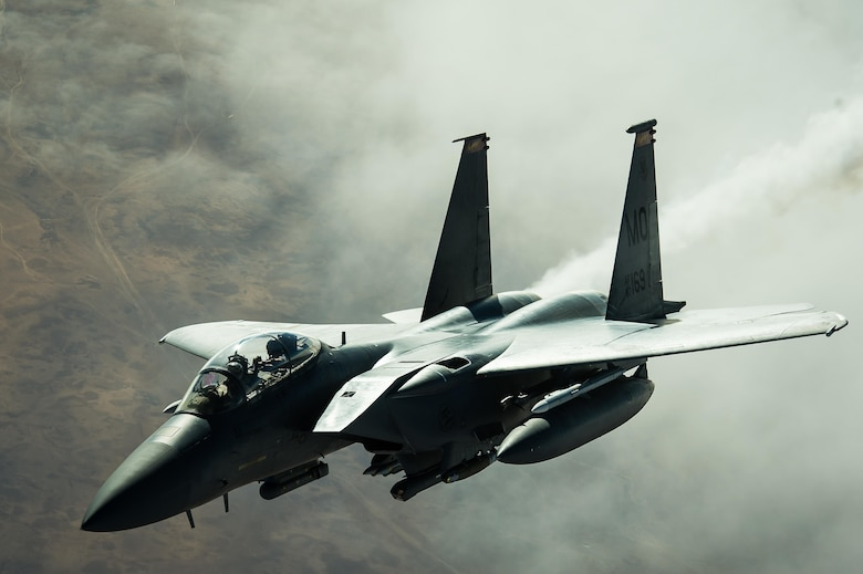 A F-15E Strike Eagle disconnects from a KC-10 Extender after receiving fuel over Iraq Dec. 5, 2016. F-15s are providing precision guided close air support during Combined Joint Task Force-Operation Inherent Resolve, a multinational effort to weaken and destroy the Islamic State in Iraq and the Levant operations in the Middle East region and around the world. (U.S. Air Force photo/Senior Airman Tyler Woodward)