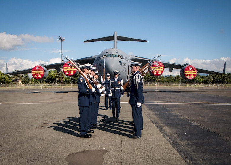 The U.S. Coast Guard Silent Drill Team performs for visitors during a joint static aircraft display on the flightline at Joint Base Pearl Harbor-Hickam, Hawaii, Dec. 6, 2016. The display, which featured a diverse range of aircraft, was open to all service members, family and veterans interested learning more about modern military aviation during the weeklong series of events commemorating the 75th anniversary of the attacks on Pearl Harbor and Oahu. (U.S. Air Force photo/Tech. Sgt. Alison Bruce-Maldonado)