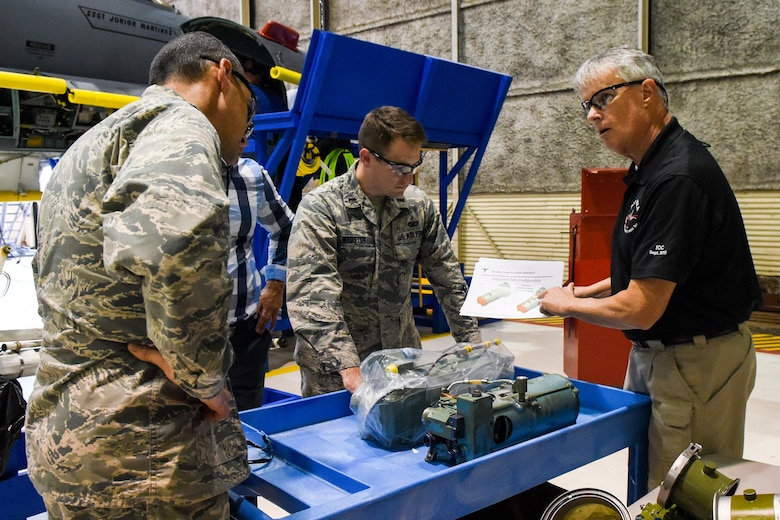 Kevin Kelly (right), Boeing Co. Radar Modernization Program integrator, shows the group a liquid cooling pump from the F-15E Strike Eagle, Oct. 3, 2016, at Seymour Johnson Air Force Base, North Carolina. Boeing Co. is contracted to install the upgrade of a new radar system from the old legacy APG-70 mechanically-scanned radar to an active electronically-scanned radar system APG-82. (U.S. Air Force photo by Airman Shawna L. Keyes)