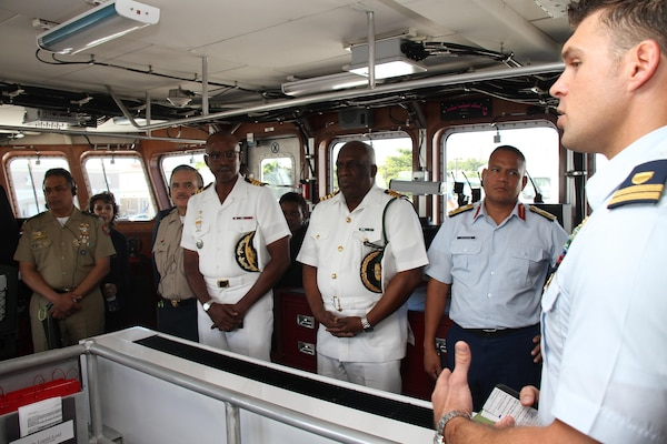 Coast Guard Lt. David Gilbert, commanding officer of the fast response cutter USCGC Richard Dixon, briefs chiefs of defense and public security ministers attending the 15th Caribbean Nations Security Conference in San Juan, Puerto Rico, Dec. 7, 2016. Conferees examined trends, challenges and threats impacting stability in the Caribbean and defined a collective strategy to improve their forces' collaboration in support of regional security. Southcom photo by Jose Ruiz