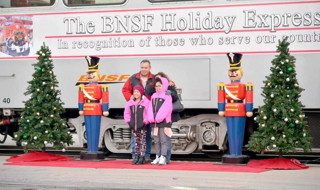A family takes a photo at the nutcracker holiday display before boarding the Holiday Express. Burlington Northern and Santa Fe Railway Company, a nationwide freight transportation company, has been running its Holiday Express for the past eight years to give members of the military and their families the experience of riding a train. About 300 people experienced the holiday train ride.