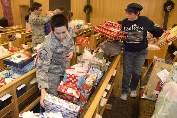 Master Sgt. Jennifer Laplante, 75th Dental Squadron, and Marjorie Cremer, volunteer, sort gifts Dec. 7 at the Hill AFB Chapel for the annual Angel Tree program. Volunteers organized donated gifts for distribution to military families. (U.S. Air Force photo by Todd Cromar)