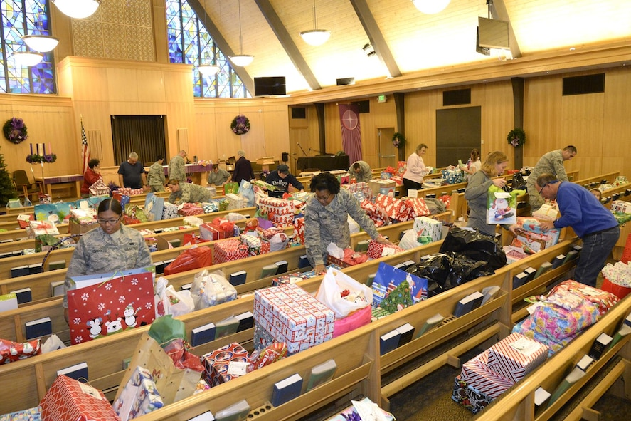 Team Hill volunteers sort gifts Dec. 7 at the Hill AFB Chapel for the annual Angel Tree program. Volunteers organized donated gifts for distribution to military families. (U.S. Air Force photo by Todd Cromar)