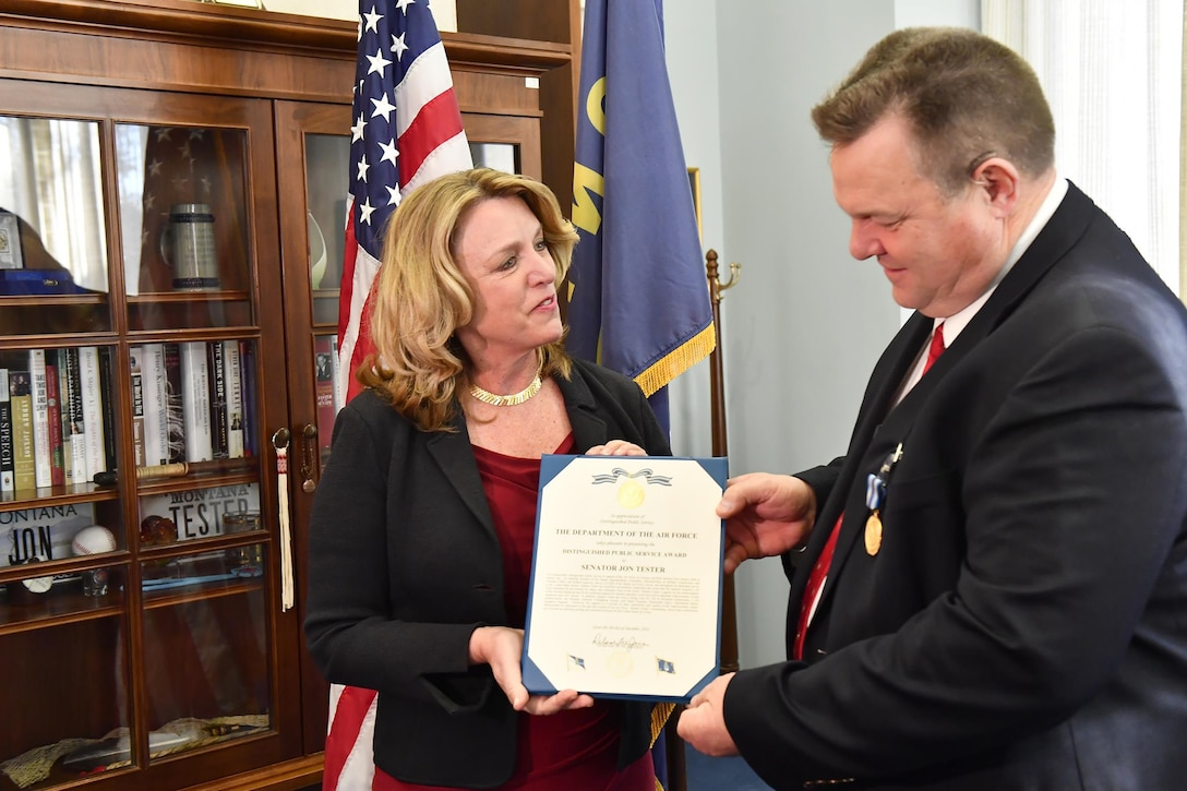 Air Force Secretary Deborah Lee James presents the Distinguished Public Service Award to U.S. Rep. Jon Tester (D-Mont.), Dec. 9, 2016, in Washington, D.C. Tester was also a strong voice for UH-1N helicopter replacement, C-130 Hercules modernization, the Modular Airborne Firefighting System, and Rapid Engineer Deployable Heavy Operational Repair Squadron Engineer.(U.S. Air Force photo/Scott M. Ash)