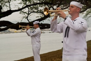 Navy Petty Officer 1st Class Brandon Barbee and Navy Petty Officer 2nd Class Rick Baty perform at the remembrance ceremony for the crew members of the USS Nevada killed in the attack on Pearl Harbor, at Joint Base Pearl Harbor-Hickam, Hawaii, Dec. 8, 2016. Seventy-six men died of wounds from the surprise Japanese attack. DoD photo by Lisa Ferdinando