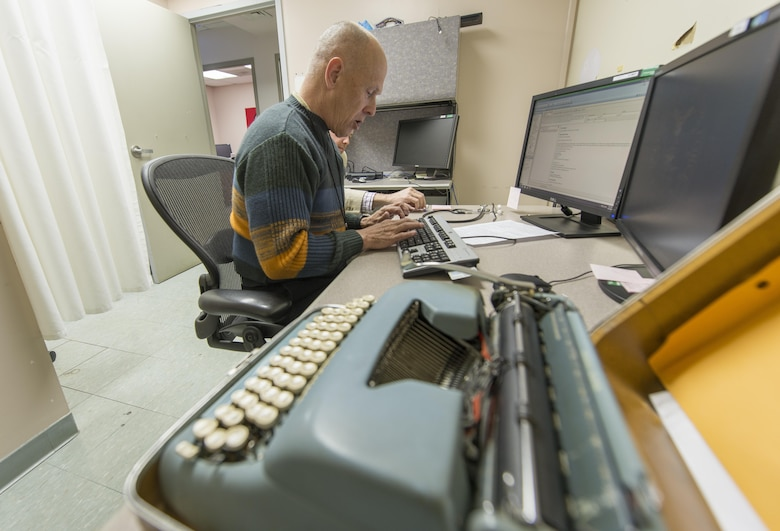Retired Col. Pete Mapes, a pilot-physician, still uses a typewriter when he sees patients at the Joint Base Andrews, Md., Flight Medicine Clinic, April 7, 2016. Mapes was instrumental to the employment of the Automatic Ground Collision Avoidance System (Auto GCAS) in fighter jets across the Air Force after he discovered an error in the program data while at the Air Force Research Lab at Wright Patterson AFB, Ohio in 2003. The system, which constantly compares the aircraft's speed and position to a digital terrain map and will automatically take control if it detects an imminent ground collision, is credited with saving the lives of four pilots. (U.S. Air Force photo/Master Sgt. Brian Ferguson)