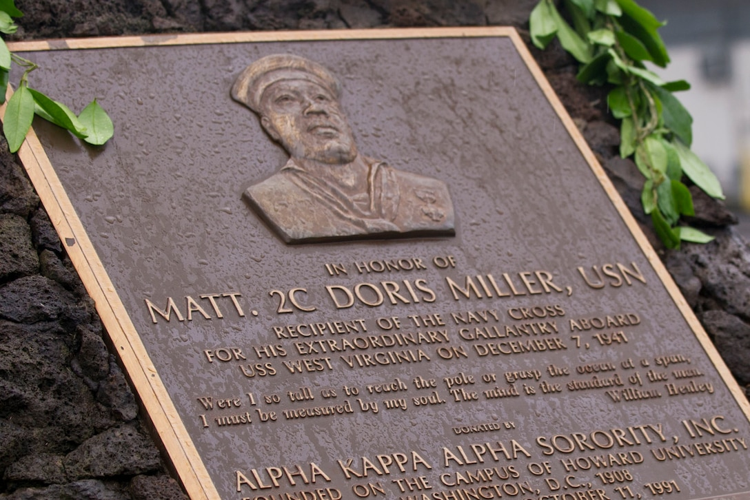 "The plaque honoring Navy Mess Attendant Second Class Doris ""Dorie"" Miller is seen, Honolulu, Hawaii, Dec. 8, 2016. DoD photo by Lisa Ferdinando"