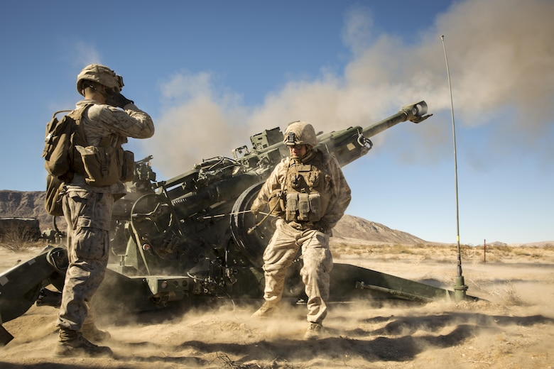 "Marines with Battery K, 3rd Battalion, 11th Marine Regiment, fire an M777A2 Howitzer in the Quackenbush Training Area aboard the Marine Corps Air Ground Combat Center, Twentynine Palms, Calif., Dec. 3, 2016, during the regiment's ""Top Gun"" competition. (Official Marine Corps photo by Cpl. Levi Schultz/Released)"