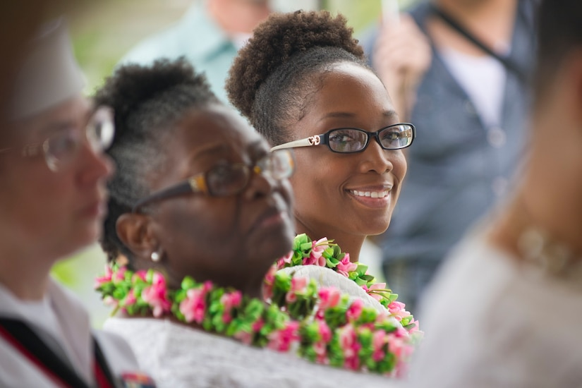 """Ginger Knowles with the Alpha Kapp Alpha Sorority looks out from the crowd during the ceremony to rededicate a plaque named after Navy Mess Attendant Second Class Doris """"Dorie"""" Miller, Honolulu, Hawaii, Dec. 8, 2016. DoD photo by Lisa Ferdinando"""
