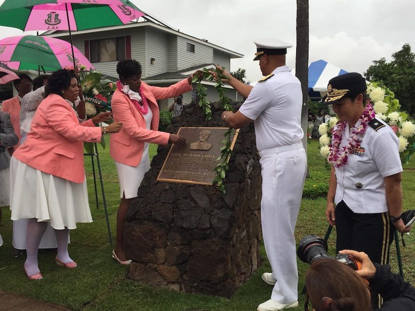 """Navy Rear Adm. John Fuller, the commander of Navy Region Hawaii, and of Naval Surface Group, Middle Pacific, takes part in the ceremony to rededicate a plaque in honor of Navy Mess Attendant Second Class Doris """"Dorie"""" Miller, Honolulu, Hawaii, Dec. 8, 2016. DoD photo by Lisa Ferdinando"""
