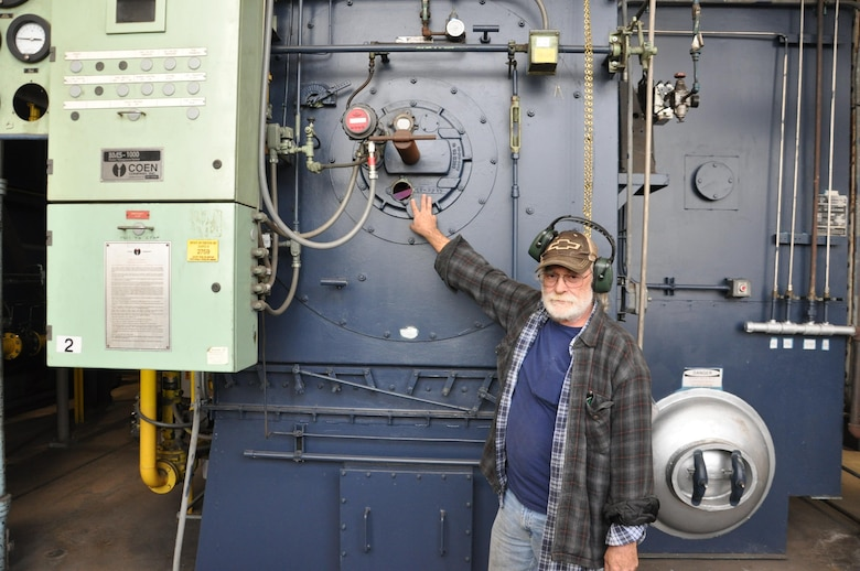Bill Livesay, Boiler Plant supervisor, inspects one of the big boilers at Wright-Patterson Air Force Base. (U.S. Air Force photo/W. Eugene Barnett Jr.)