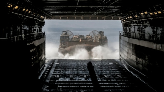 GULF OF ADEN (Dec. 6, 2016) A landing craft air cushion (LCAC) debarks from the stern gate of the USS Somerset (LPD 25) caring U.S. Marines and their light armored vehicles during an amphibious assault rehearsal as part of exercise Alligator Dagger, Dec. 6, 2016. The LCAC is one means for an amphibious ready group and a Marine expeditionary unit to conduct logistical movements, carrying troops, vehicles, and equipment from ship to shore. The Makin Island Amphibious Ready Group and the 11th MEU is operating in the U.S. 5th Fleet area of responsibility in support of maritime security operations and theater security cooperation efforts to ensure the free flow of commerce, freedom of navigation and regional security. (U.S. Marine Corps photo by Lance Cpl. Zachery C. Laning)