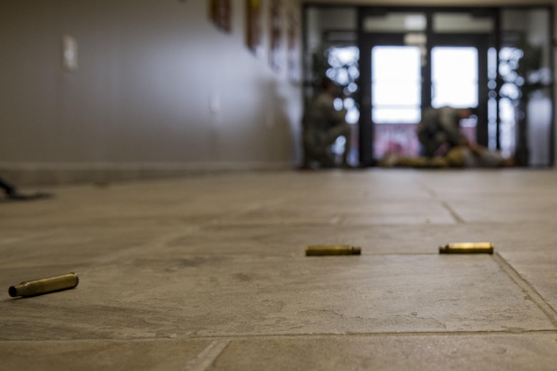 Bullet casings rest on the floor as members of the 23d Security Forces Squadron detain the simulated active shooter, Staff Sgt. Christopher Childress, 23d SFS military working dog trainer, during an active shooter exercise, Dec. 8, 2016, at Moody Air Force Base, Ga. This exercise caused included securing entrances to nearly every building on base. (U.S. Air Force photo by Airman 1st Class Daniel Snider)