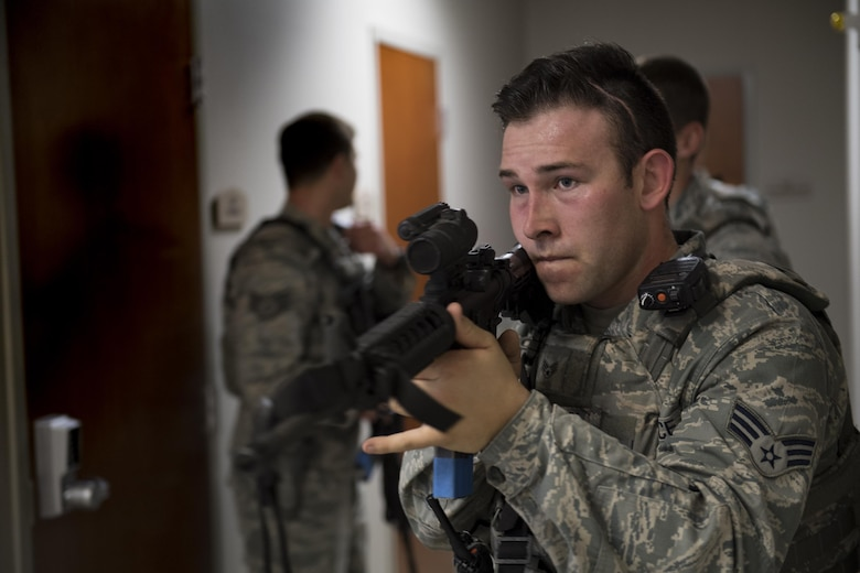 Senior Airman Matthew McFarlin, 23d Security Forces Squadron entry controller, advances down a hallway during an active shooter exercise, Dec. 8, 2016, at Moody Air Force Base, Ga. Members of the 23d SFS systematically moved through the building ensuring no additional threats were present. (U.S. Air Force photo by Airman 1st Class Daniel Snider)