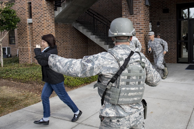 A member of the 23d Security Forces Squadron directs people away from the crime scene during an active shooter exercise, Dec. 8, 2016, at Moody Air Force Base, Ga. After 23d SFS declared the scene safe people were allowed to evacuate the building. (U.S. Air Force photo by Airman 1st Class Daniel Snider)