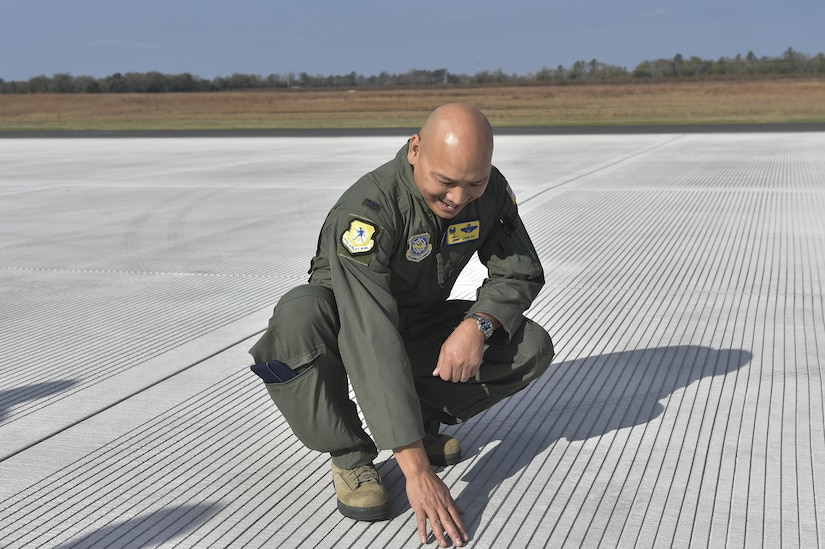 U.S. Air Force Col. Jimmy Canlas, 437th Airlift Wing commander, admires the recent repairs to the North Auxiliary Airfield runway in North, South Carolina Dec. 8, 2016. The runway, originally constructed with asphalt, was deteriorating.