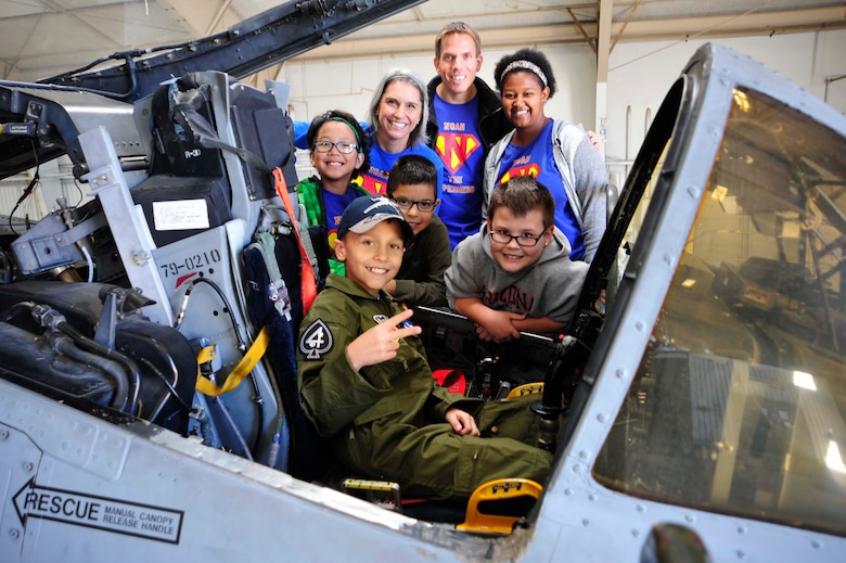 "Noah Hepner, 10, poses for a photo with his family and friends in front of an A-10C Thunderbolt II during his visit to the 47th Fighter Squadron as part of the ""Pilot for a Day"" program at Davis-Monthan Air Force Base, Ariz., Dec. 4, 2016. The goal of the program, which focuses on children of all ages who have terminal or chronic conditions, is to give each child and family a special day and a break from the daily challenges they face. (U.S. Air Force photo by Tech. Sgt. Courtney Richardson)"