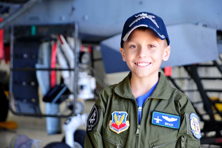 "Noah Hepner, 10, smiles for a photo while visiting the 47th Fighter Squadron as part of the ""Pilot for a Day"" program at Davis-Monthan Air Force Base, Ariz., Dec. 4, 2016. Noah was diagnosed with High Risk Acute Lymphoblastic Leukemia, August 2015. (U.S. Air Force photo by Tech. Sgt. Courtney Richardson)"