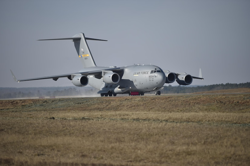 A C-17 Globemaster III performs air assault landing training at North Auxiliary Airfield in North, South Carolina, Dec. 8, 2016. The training marked the completion of a six-month runway repair project.