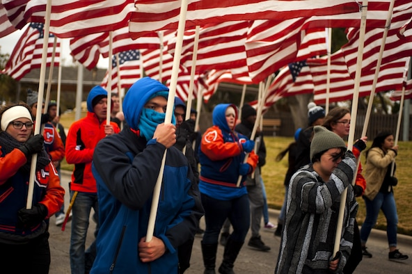 Central High School students bear flags during the Heroes Hunt Parade at Santa Fe Park in San Angelo, Texas, Dec. 8, 2016. San Angelo hosts the Hero's Hunt Parade for veterans from all over Texas to honor them for their service. (U.S. Air Force photo by Senior Airman Scott Jackson/released)