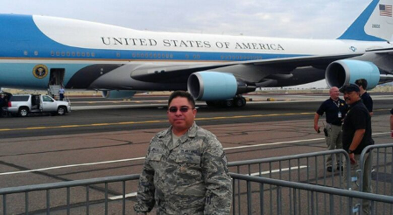 Courtesy photo of retired Senior Master Sgt. Hector Baca, Jr. posing for a photo in front of Air Force One.