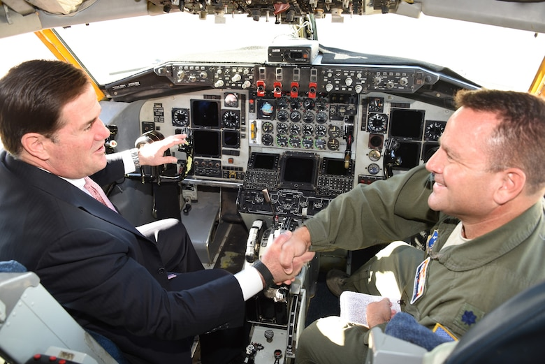 Gov. Doug Ducey shakes hands with Lt. Col. Tyler Griffith, commander of the 197th Air Refueling Squadron in the cockpit of a KC-135 Stratotanker aircraft, Dec 9, 2016. Ducey was touring the aircraft during the Goldwater Air National Guard Base name dedication ceremony.(U.S. Air National Guard photo by Technical Sgt. Michael Matkin)