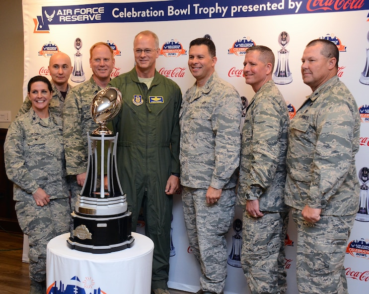 Brig. Gen. Steven Parker, 94th Airlift Wing commander (center), along with members of Dobbins Leadership take center stage with the U.S. Air Force Reserve Celebration Bowl trophy at Dobbins Air Reserve Base, Ga. Dec. 9, 2016.  The North Carolina Central University Eagles and the Gambling State Tigers are slated to go head-to-head in the bowl game on Dec. 17th. (U.S. Air Force photo/Don Peek)
