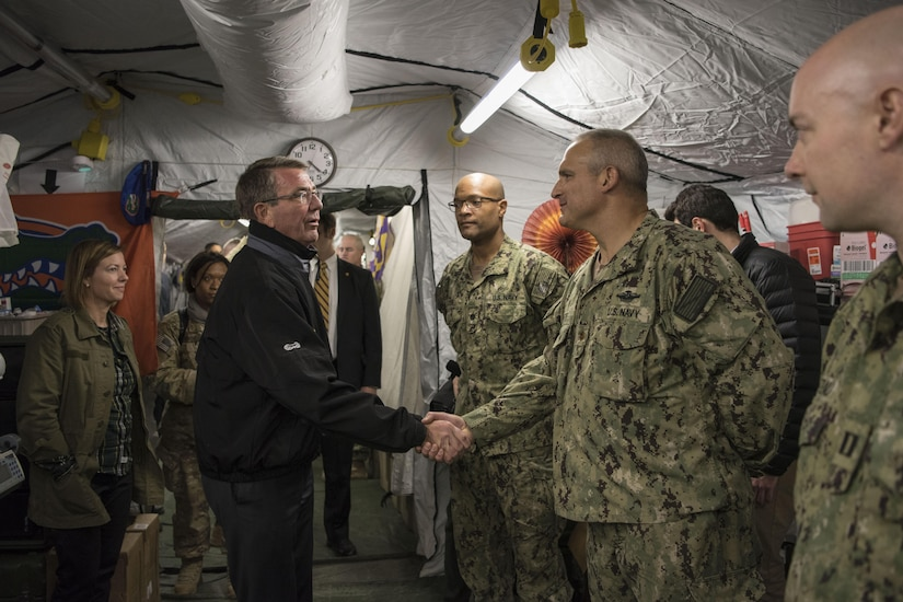 Defense Secretary Ash Carter shakes hands with troops serving at Qayyarah Airfield West, Iraq, Dec. 11, 2016. DOD photo by Air Force Tech. Sgt. Brigitte N. Brantley